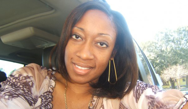 This undated family photo, provided by Lincoln B. Alexander, shows Marissa Alexander in her car in Tampa, Florida.