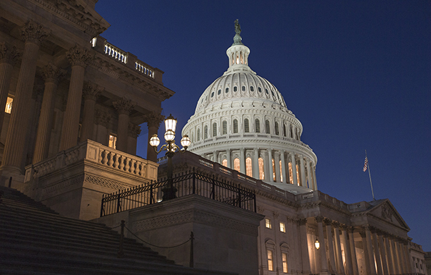 In a rare weekend session at the Capitol, the House of Representatives works into the night to pass a bill to fund the government, Saturday, September 28, 2013.