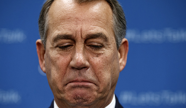 House Speaker John Boehner (R-OH) pauses during a news conference on Capitol Hill in Washington, Tuesday, October 8, 2013.