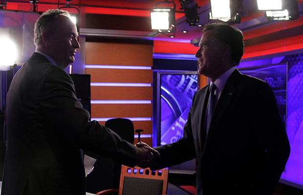 "Former Republican presidential candidate Mitt Romney, right, shakes hands with Bill O'Reilly after his interview for O'Reilly's Fox News program ""The O'Reilly Factor,"" in New York, Monday, December 19, 2011."