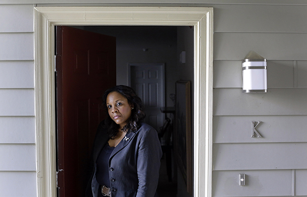 Felicia Evans Long, a program analyst at the National Institutes of Health who is currently furloughed due to the partial federal government shutdown, stands outside her home in Rockville, Maryland, Thursday, October 3, 2013.