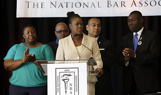 Sybrina Fulton, mother of slain teenager Trayvon Martin, center, speaks during a news conference held by the National Bar Association, Monday, July 29, 2013, in Miami Beach, Florida.