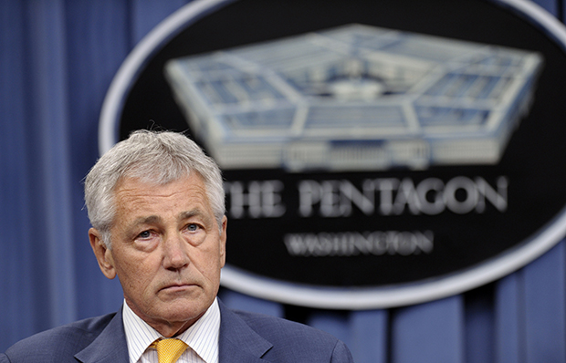 Defense Secretary Chuck Hagel listens during a news conference at the Pentagon, Wednesday, June 26, 2013.
