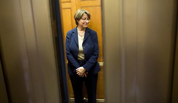 Sen. Amy Klobuchar (D-MN) gets on an elevator on Capitol Hill on Monday, October 14, 2013, in Washington.