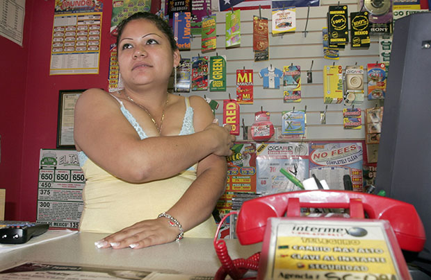 Macrina Castillo of Mexico is shown at her place of work, the Mundo de Musica Latina music store in Columbia, South Carolina.