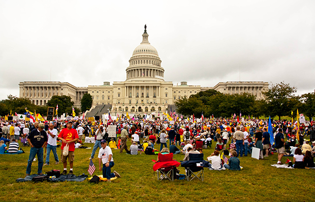 Tea Party protestors take part in an anti-tax march outside the Capitol in Washington, September 12, 2010.