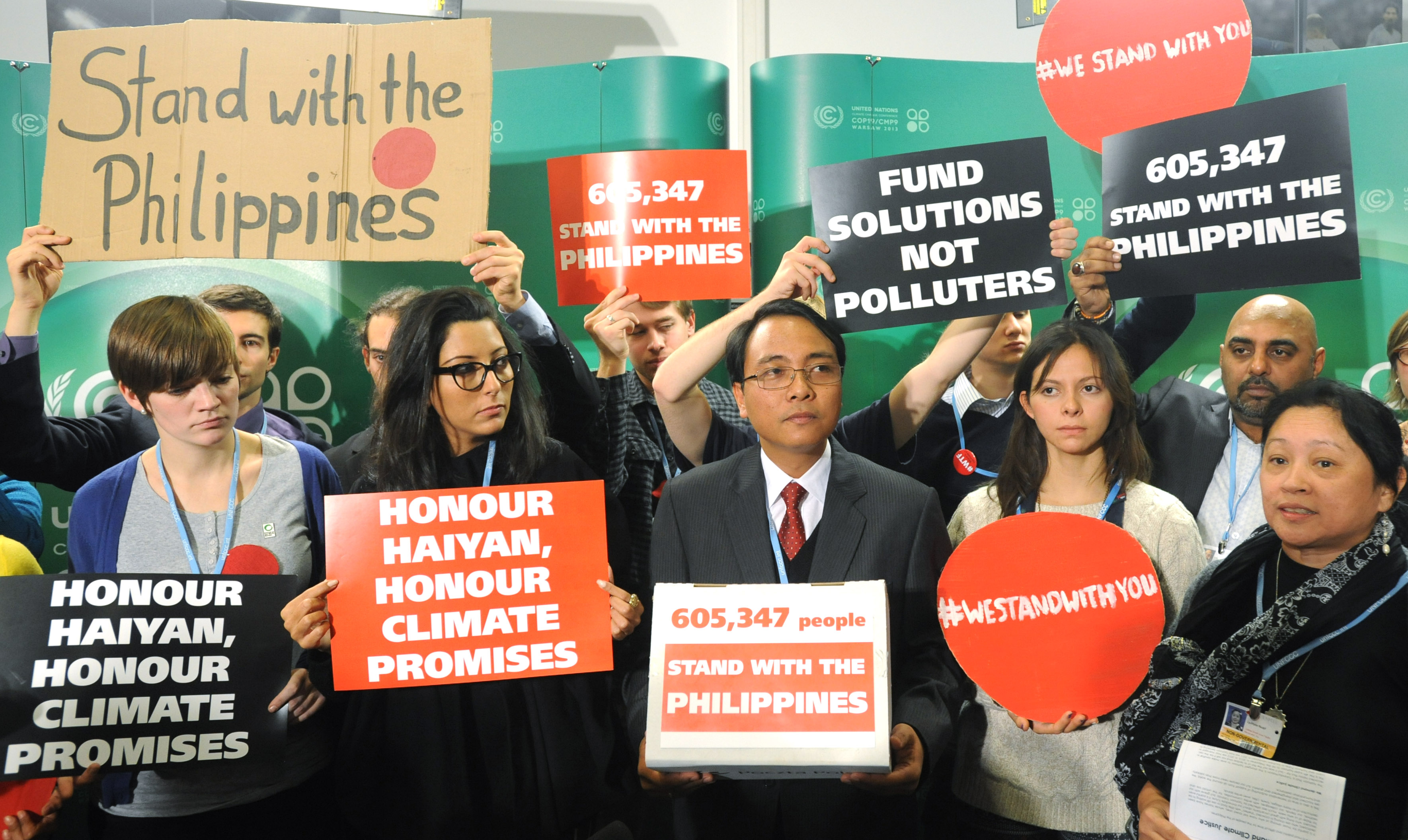 Philippines' delegate Yeb Sano delivers a global petition calling for urgent action to prevent more super typhoons to delegates at the U.N. Climate Conference in Warsaw.