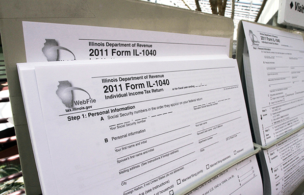 A 2011 1040 tax form is seen with other tax forms at the entrance of the Illinois Department of Revenue in Springfield, Illinois.