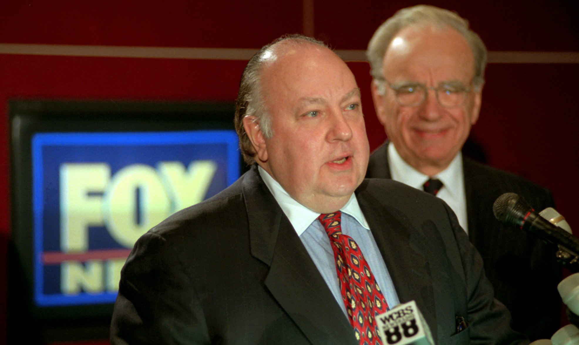 Roger Ailes, left, answers questions after Rupert Murdoch, right, announced Ailes would lead Fox News in 1996.