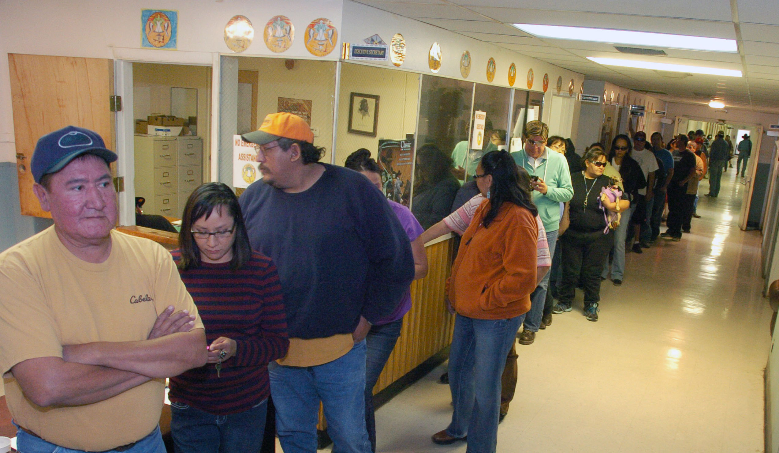Crow Tribe employees line up to receive their paychecks. These are some of more than 300 tribal employees who were furloughed during the federal government shutdown.