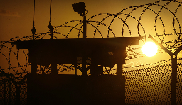 In this photo reviewed by the U.S. military, the sun rises above Camp Delta at Guantanamo Bay Naval Base, Cuba, Wednesday, November 20, 2013.