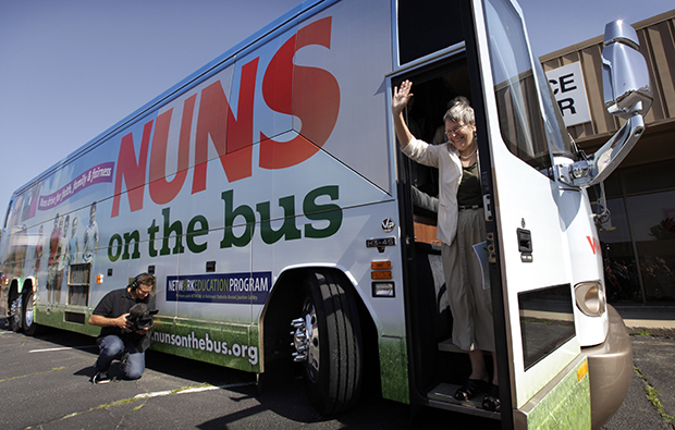 Sister Simone Campbell, executive director of NETWORK, waves as she steps off the bus during a stop on the first day of a nine-state Nuns on the Bus tour, Monday, June 18, 2012, in Ames, Iowa.