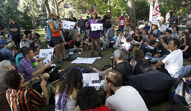 Activists associated with the Occupy Wall Street movement participate in a general assembly during a gathering of the movement in Washington Square park, Saturday, September 15, 2012, in New York.