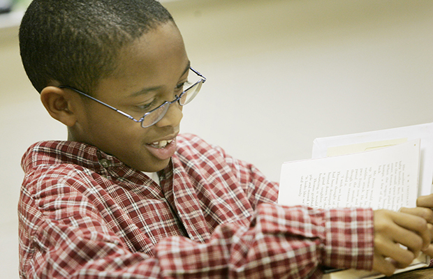 A fourth-grader reads in class.