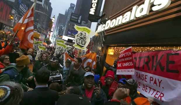 Demonstrators rally for better wages outside a McDonald's restaurant in New York, as part of a national protest, Thursday, December 5, 2013.