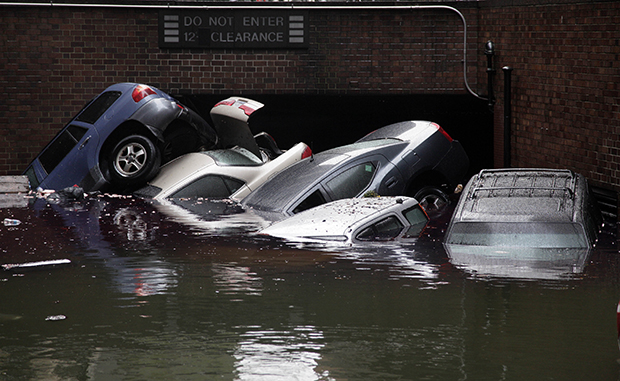 Cars are submerged at the entrance to a parking garage in New York's Financial District in the aftermath of Superstorm Sandy, Tuesday, October 30, 2012.