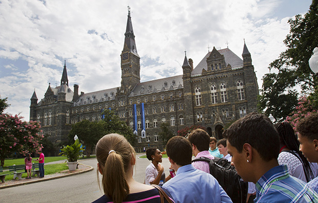 Prospective students tour Georgetown University's campus in Washington, Wednesday, July 10, 2013.