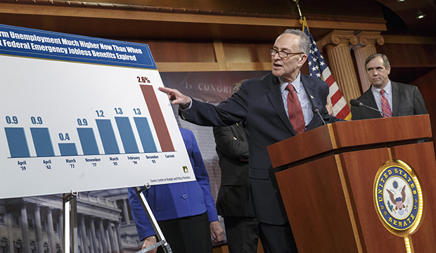 Sen. Charles Schumer (D-NY), left, accompanied by Sen. Jeff Merkley (D-OR), meets with reporters on Capitol Hill in Washington, Tuesday, January 7, 2014.