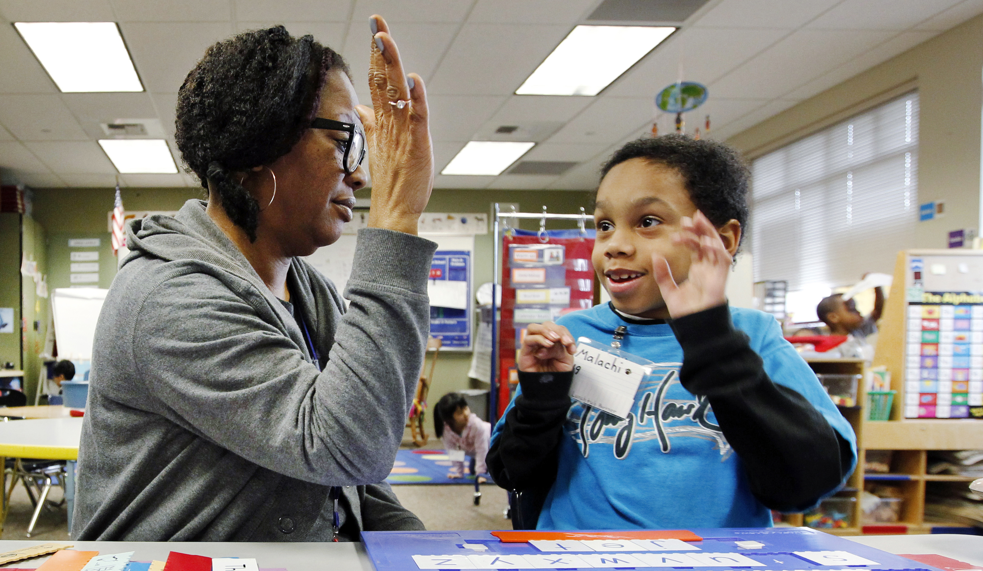 Malachi Stewart works with educational assistant Addison Hawk at Campbell Hill Elementary in Renton, Washington.