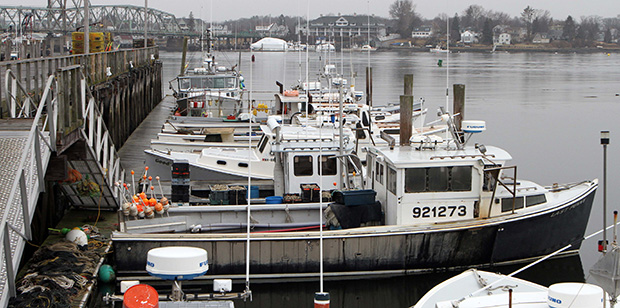 Fishing boats are seen at the Commercial Fishing Pier in Portsmouth, New Hampshire, February 1, 2012.