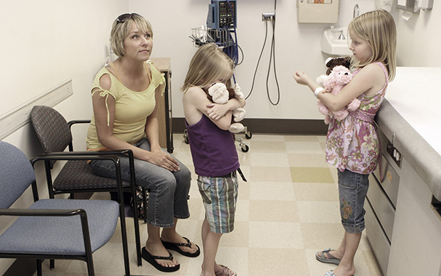 Natalie Van Noy, left, sits with her daughters Shayde Smith, 8, right, and Emily Smith, 6, during a check-up with their pediatric cardiologist at Children's Medical Center in Dallas, Texas, April 23, 2008.
