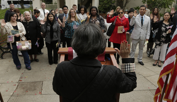 Mari Carmen Jorden, district director of the U.S. Citizenship and Immigration Services, administers the oath of citizenship during a naturalization ceremonies in Sacramento, California.