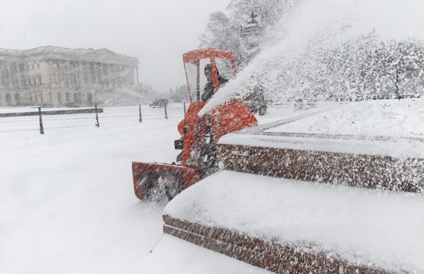 A Capitol Hill worker clears snow on Capitol Hill in Washington, D.C.