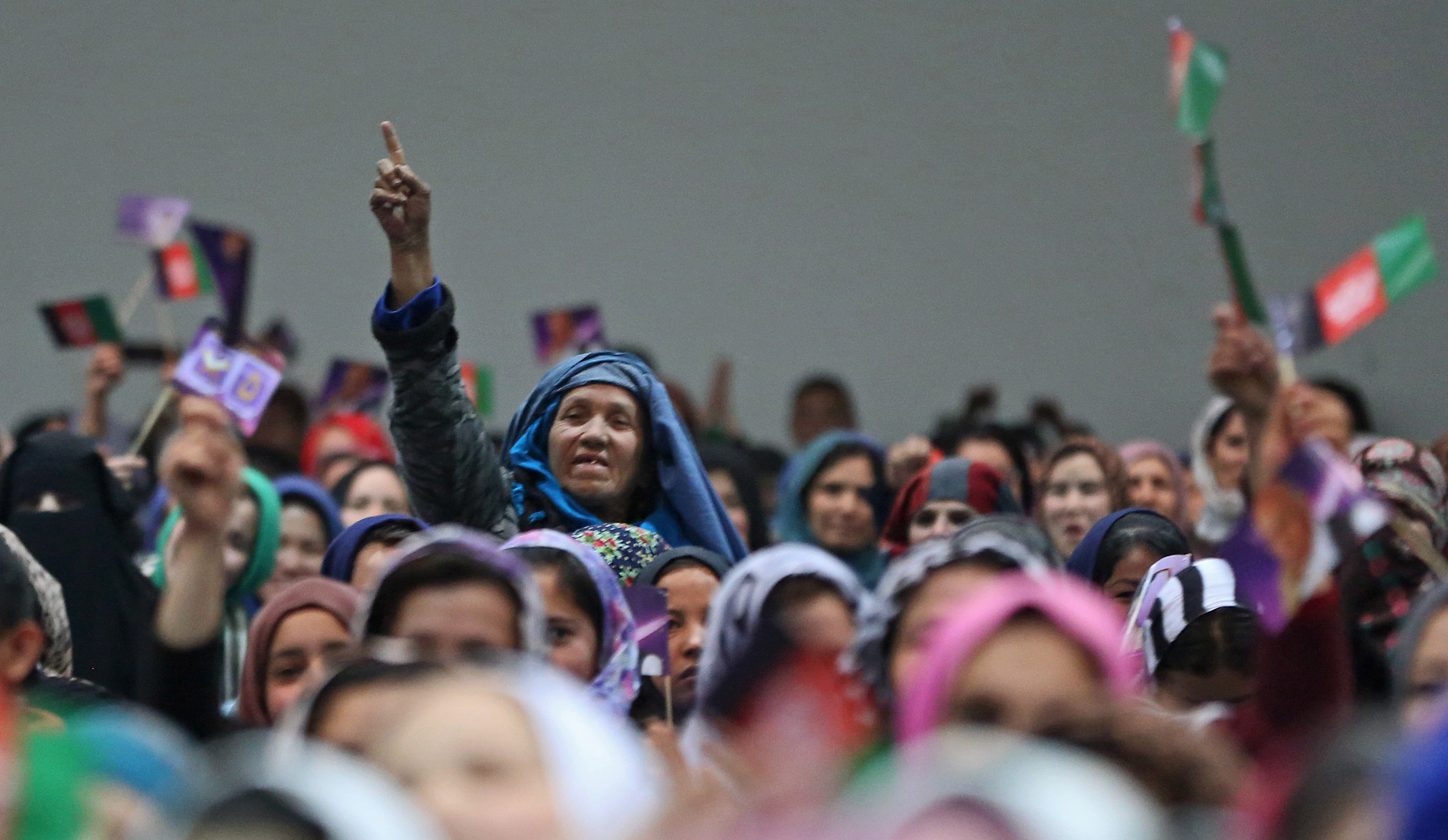 Female supporters  cheer during an Afghan presidential campaign rally.