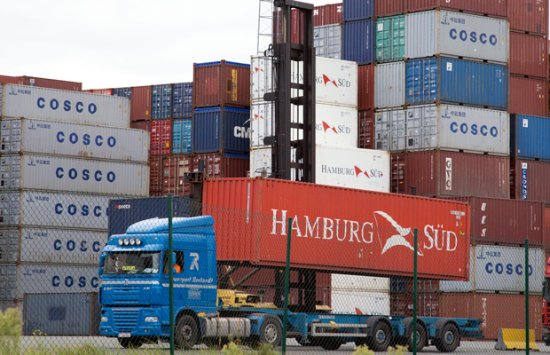 A container is removed from a transport truck in the Port of Antwerp, Belgium, as the United States and Europe concluded a second round of negotiations in November 2013 on what could become the biggest trade agreement in history: the Transatlantic Trade and Investment Partnership.
