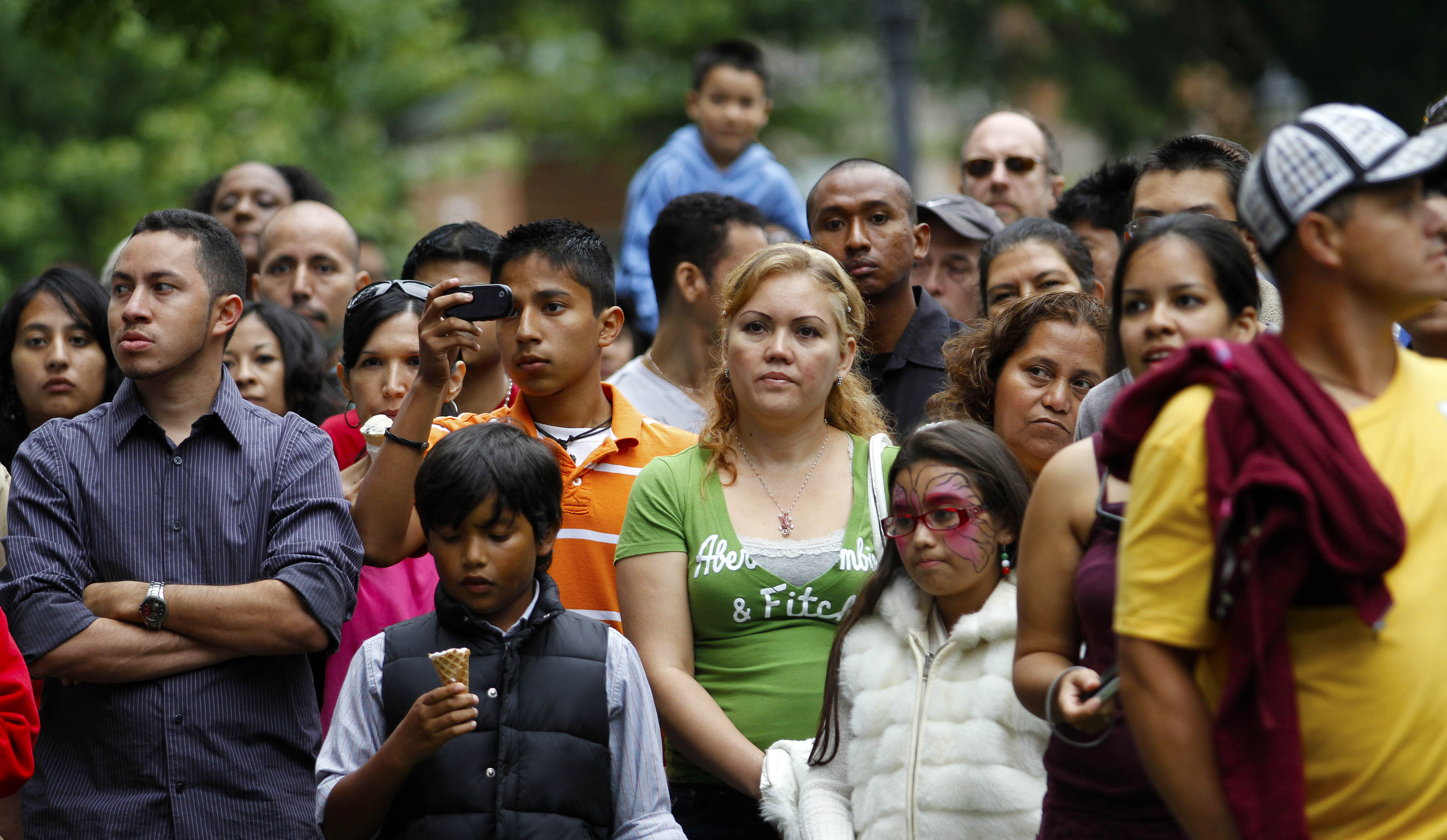 Spectators watch a musical performance at the Fiesta del Pueblo festival in Raleigh, North Carolina.