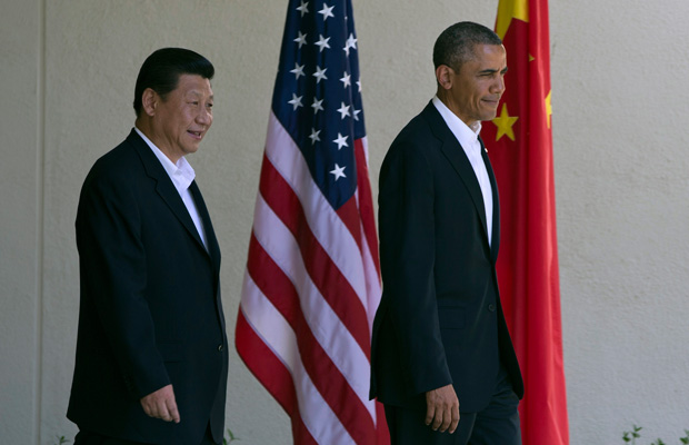 President Barack Obama walks with Chinese President Xi Jinping at the Annenberg Retreat in California.
