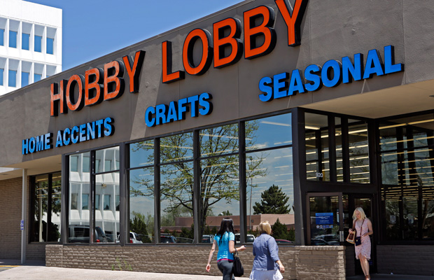 Customers are seen at a Hobby Lobby store in Denver. Hobby Lobby is challenging a federal mandate requiring it to offer employees health coverage that includes access to the morining-after birth control pill.
