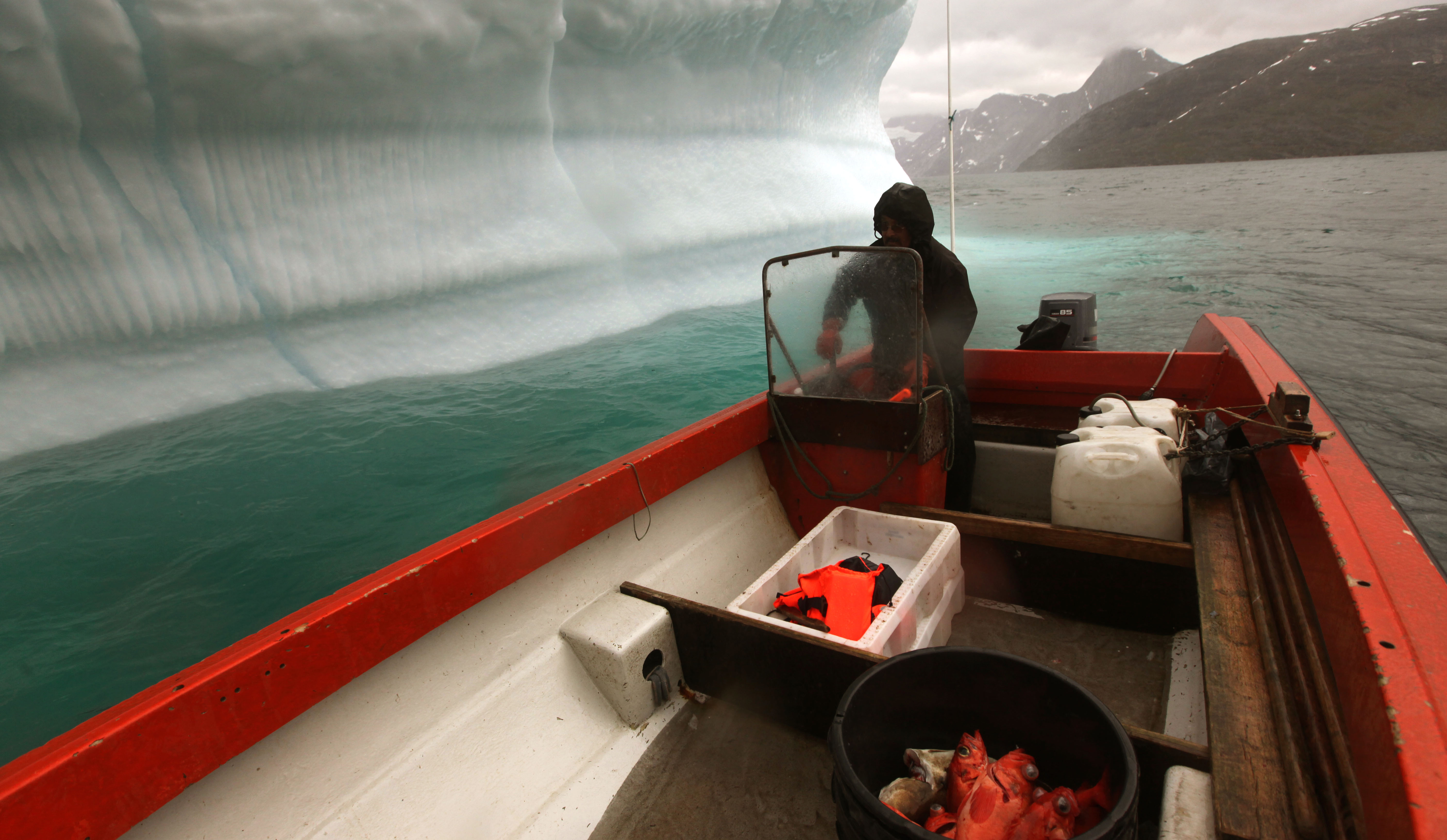 Inuit fisherman near Greenland Ice Sheet