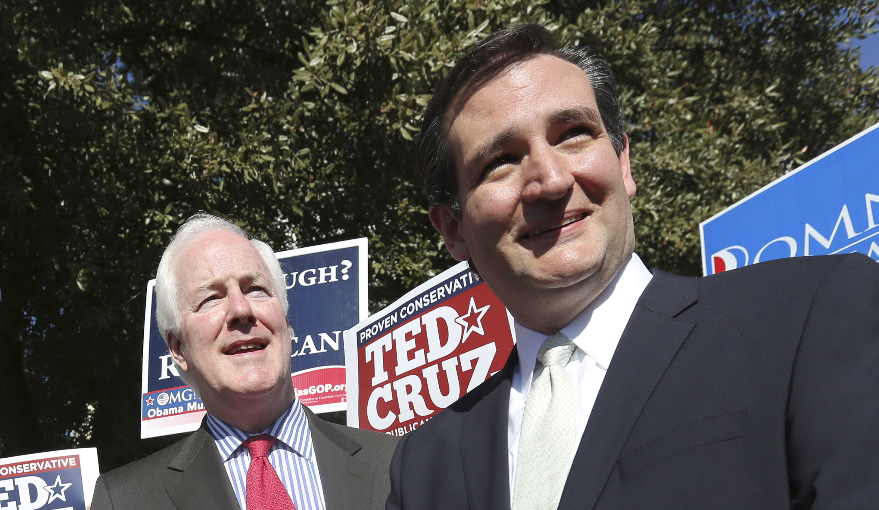Then-Senate candidate Ted Cruz (R-TX), right, and Sen. John Cornyn (R-TX) listen to a question from reporters outside a polling station in Dallas.