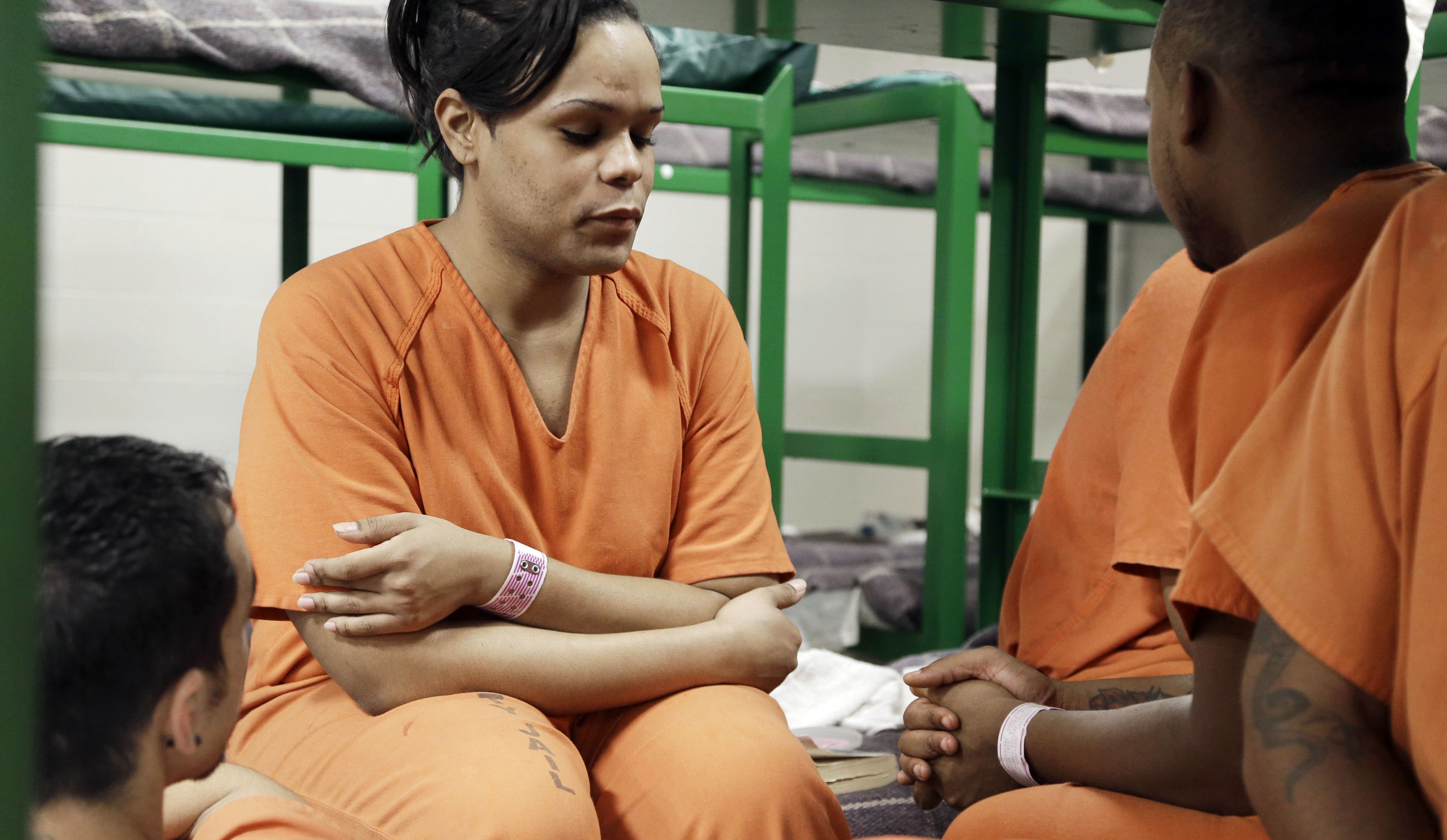Tyniehsa Stephens visits with cell mates in the Harris County Jail in Houston, one of many jails around the country implementing changes in the way it treats its LGBT population.
