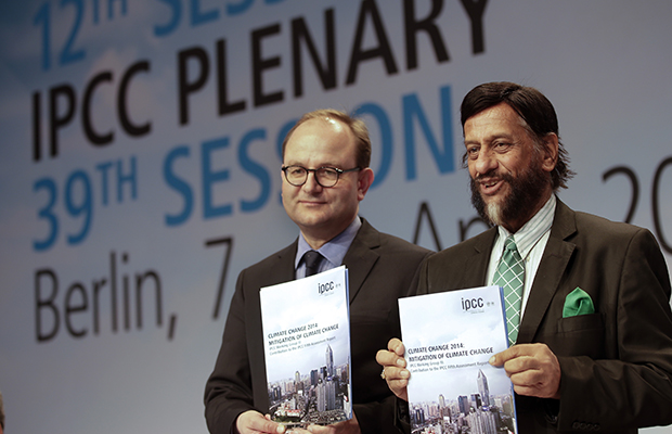 Ottmar Edenhofer, co-chairman of the Intergovernmental Panel on Climate Change's Working Group III, and Rajendra K. Pachauri, chairman of the IPCC, from left, pose prior to a press conference as part of a meeting of the IPCC in Berlin, Germany, Sunday, April 13, 2014.