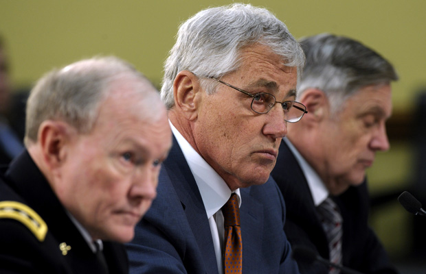 Defense Secretary Chuck Hagel, flanked by Gen. Martin Dempsey and Undersecretary of Defense Comptroller Robert Hale, testify on Capitol Hill before the House Appropriations Committee hearing on the Defense Department's fiscal 2015 budget.