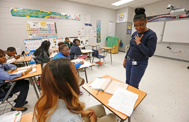Clarksdale High School chemistry instructor Victoria Dawson encourages her class to solve their equations at the board in Clarksdale, Mississippi.