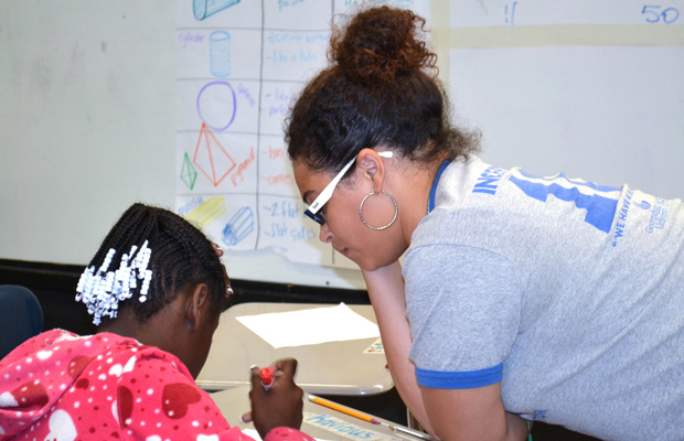 Teach for America corps member Jazmine Moore works one-on-one with a 5th grade student at Pearman Elementary School in Cleveland, Mississippi.