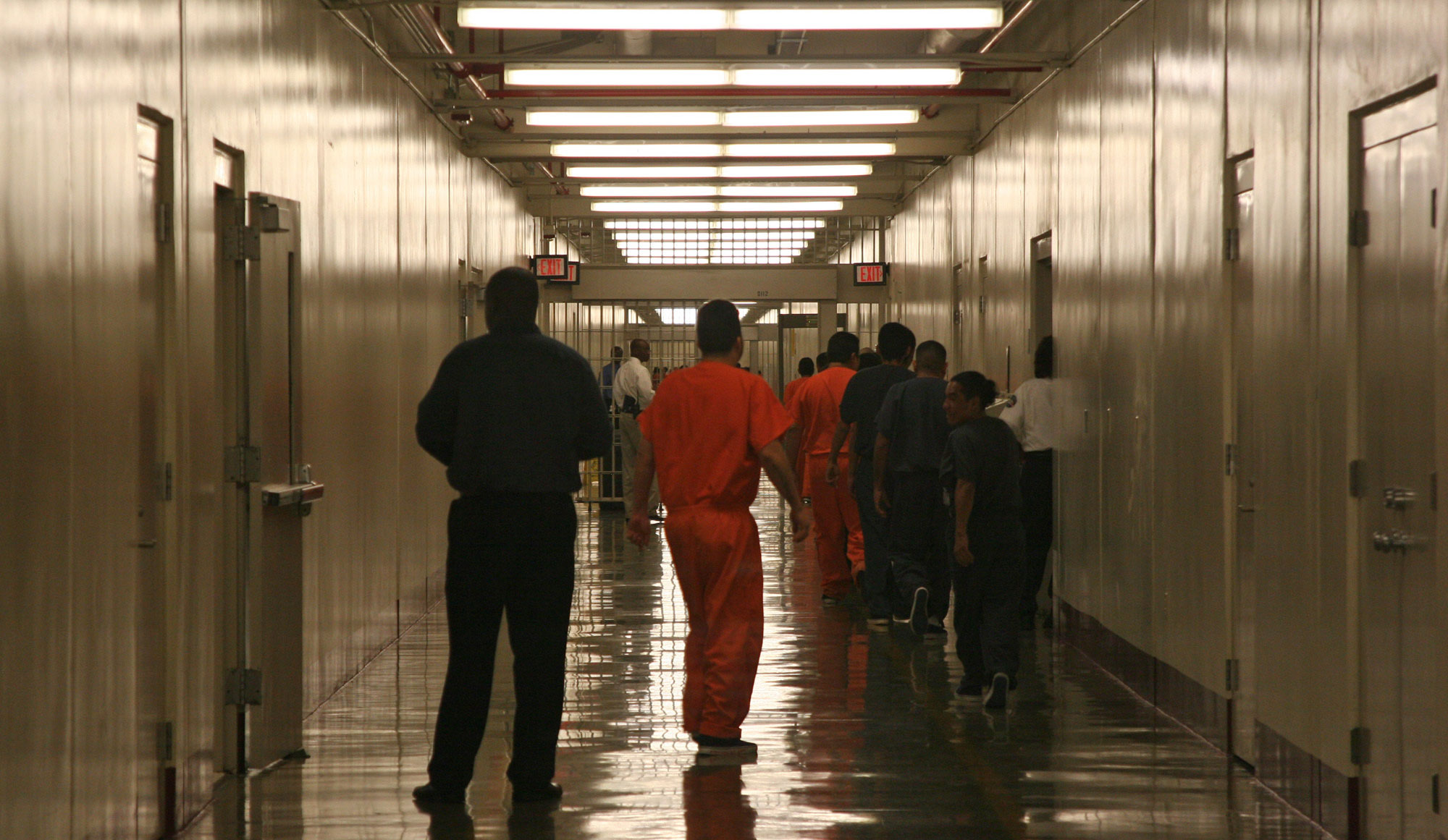 Detainees leave the the cafeteria at the Stewart Detention Facility, a Corrections Corporation of America immigration facility in Lumpkin, Georgia.