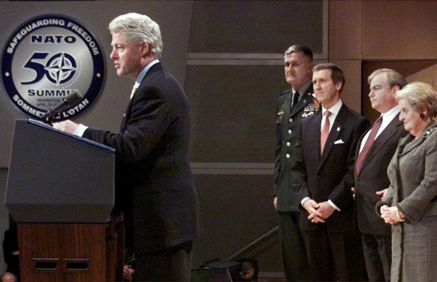 President Bill Clinton reads a statement at the conclusion of the NATO 50th anniversary summit, Sunday April 25, 1999, in the Ronald Reagan Building in Washington.
