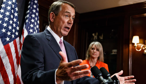 House Speaker John Boehner of Ohio, joined by Rep. Renee Ellmers (R-NC), talks to reporters following a Republican strategy meeting on Capitol Hill.