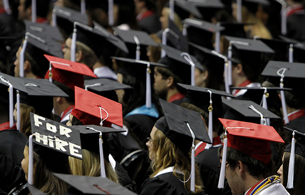 Students attend graduation ceremonies at the University of Alabama in Tuscaloosa, Alabama, August 6, 2011.
