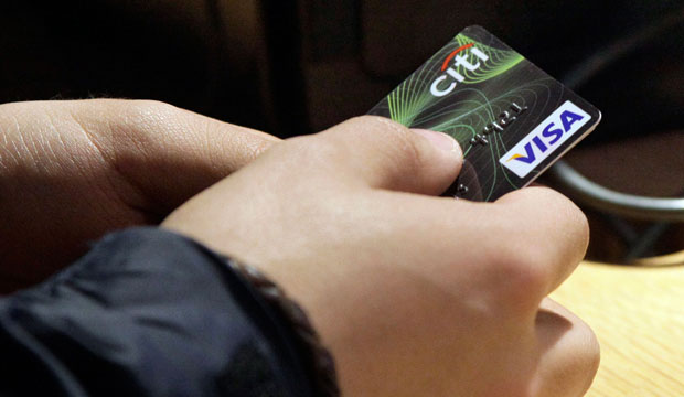 A Visa credit card is tendered at the opening of the Superdry store in New York's Times Square in May 2012.