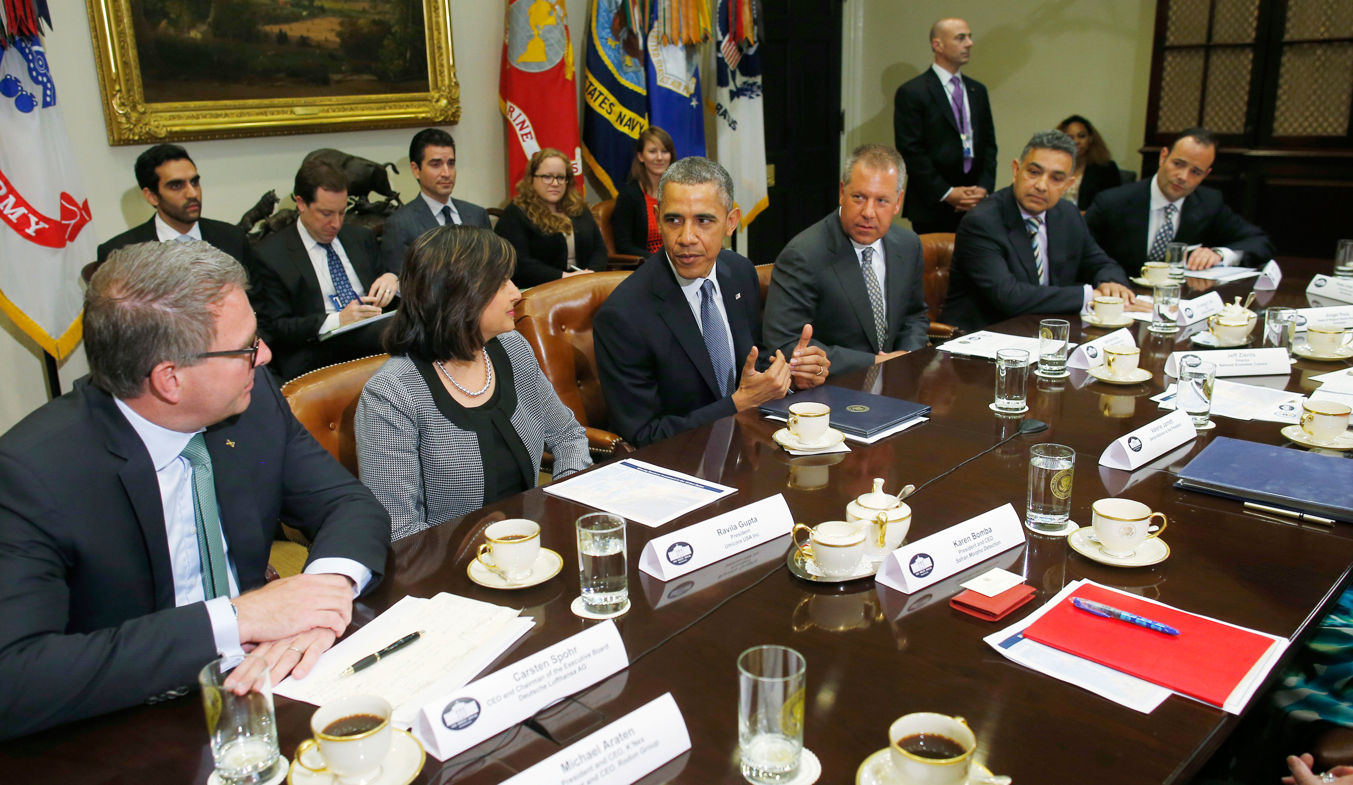 President Barack Obama meets with business leaders about creating and investing in jobs in the United States, Tuesday, May 20, 2014, in the Roosevelt Room of the White House in Washington.