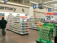 A shopper walks toward the pharmacy at a Little Rock, Arkansas, Wal-Mart store.