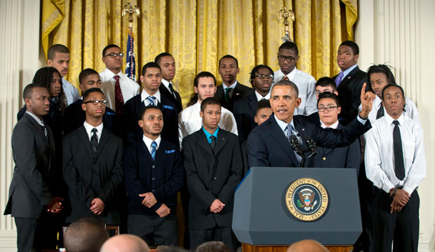 """President Barack Obama gestures during an event in the East Room of the White House to promote his """"My Brother's Keeper"""" initiative."""