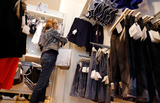 A woman shops in Pittsburgh in May as retail jobs expand.