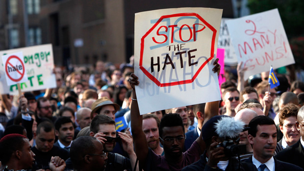 Members of the LGBT community and their supporters gather to speak out after a string of hate violence during a rally in New York's Greenwich Village, Monday, May 20, 2013.