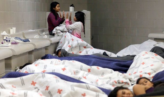 Detainees play as others sleep in a holding cell at a U.S. Customs and Border Protection processing facility in Brownsville, Texas.